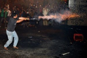 From the AFP. An Indonesian student launches fireworks towards police during a protest against the fuel price hike outside parliament in Jakarta on June 17, 2013.