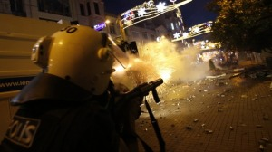 REUTERS/Murad Sezer A cop in Istanbul fires at protesters.