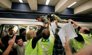 Protestor hops on top of BART train