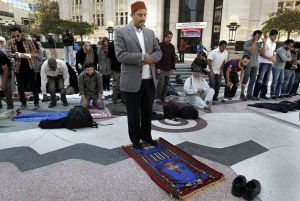 Dr Hatem Bazian leading Jummah (Friday Prayer) at Oscar Grant Plaza ( Occupy Oakland) Photo From SFGATE