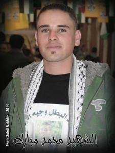 Muhammad Mubarak displaying another slain Palestinian on his t-shirt