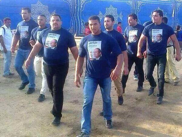 Baltagiya thugs patrolling the streets in Sisi t-shirts