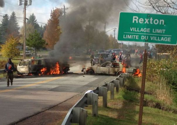 Two of six police vehicles torched, Oct 17, Mi'kmaq territory, 2013.