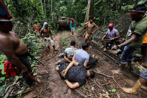 Ka'apor warriors stand guard over illegal loggers they tied up during a jungle expedition to search for and expel them from the Alto Turiacu Indian territory.