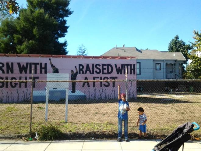 West Oakland kids before the mural was torn down