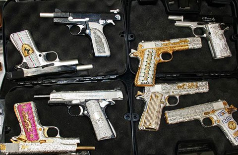 Gold and silver plated guns with jewels, confiscated from cartel members in Mexico.