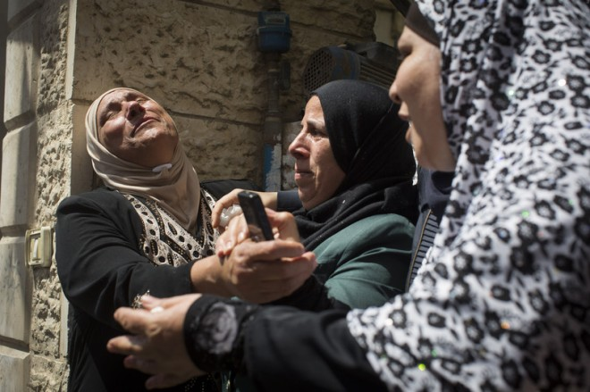 Relatives mourn during the funeral of Muhammad Abu Latifa, 27 July, in Qalandiya refugee camp, near Ramallah in the occupied West Bank. The Palestinian youth was killed as he ran from Israeli occupation forces who raided his family home. Oren Ziv ActiveStills