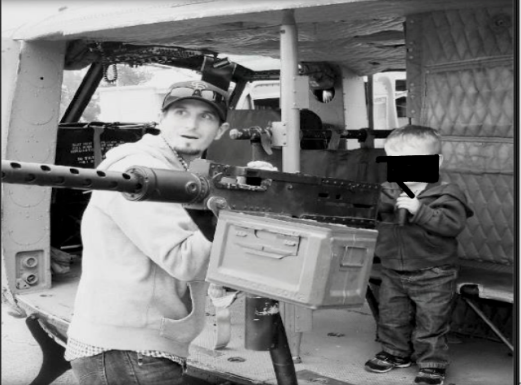 Officer Michael Lewelling teaching his 3 yr old son how shoot a 50 Cal machine gun