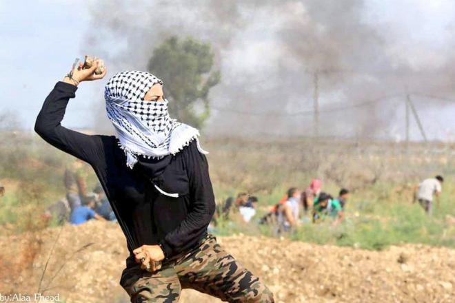 Palestinian girl in Gaza demonstrating near the buffer zone