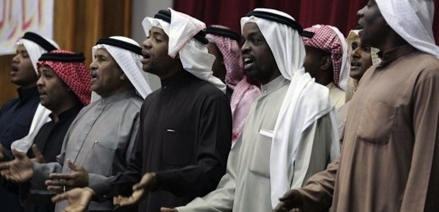 "African-Iraqi men sing after their group ""Free Iraqi Movement"" was approved as a political party to run in the coming local elections in Basra, 420 km (260 miles) southeast of Baghdad December 6, 2008. Inspired by Barack Obama's election in the United States, some black Iraqis plan to run in a forthcoming election, to end what they call centuries of discrimination because of their slave ancestry.  Picture taken December 6.  To match feature IRAQ/BLACKS     REUTERS/Atef Hassan (IRAQ)"